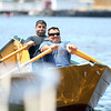 Vito Giacalone, left, and Mike Mitchell, paddle hard at the start of the Senior's Division dory race on Saturday morning. DAVID LE/Staff photo. 6/21/14.