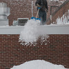Desi Smith Staff photo/Gloucester Daily Times.   Barry Hayes clears snow from the roof of the Pilot House on Roders St during Friday mornings storm.        January 3,2013.