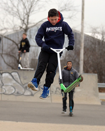 RYAN HUTTON/ Staff photo<br /> Cam Mickels, 11, flips his scooter around while in the air at the skate park at O'Maley Innovation Middle School.