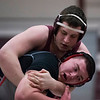 SAM GORESH/Staff photo. Gloucester's Chris Jaques wrestles Wakefield's Dan Di Meglio in the 220 pound bout during the Super Quad tournament. 1/7/17