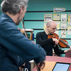 SAM GORESH/Staff photo. From left: Colin Jacobsen on violin, and Nicholas Cords on viola, of string quartet Brooklyn Rider, perform for third graders at Rockport Elementary School. 1/24/17