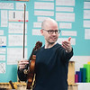 SAM GORESH/Staff photo. Nicholas Cords who plays viola with the string quartet Brooklyn Rider answers questions from third graders at Rockport Elementary School. 1/24/17