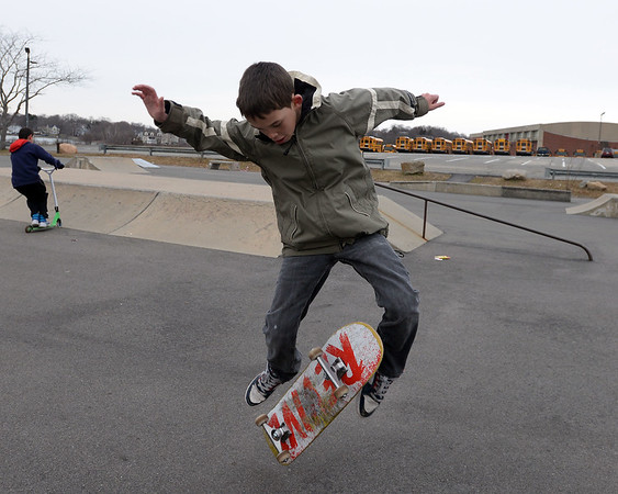 RYAN HUTTON/ Staff photo<br /> Kyle Fournier, 11, does a kick flip at the skate park at O'Maley Innovation Middle School.