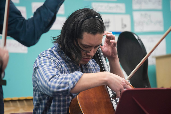 SAM GORESH/Staff photo. Michael Nicolas plays the cello with two other members of the string quartet Brooklyn Rider as they perform for third graders at Rockport Elementary School. 1/24/17