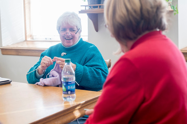 """Camilla Ayers (left) chats with Dianne Wemyss (right) as they knit and crochet during the """"Which Craft? Circle"""" at the Rockport Public Library. Ayers founded the group and decided to call it """"Which Craft"""" so that people could bring all types of needle crafts to the group. Ayers is knitting a sweater for a cousin's baby and Wemyss is crocheting an afghan for a niece's wedding present. 1/9/17"""