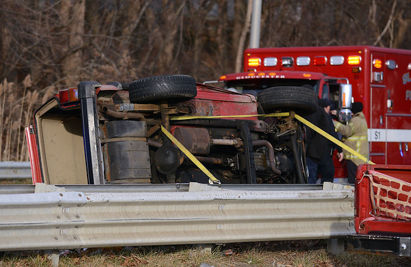 RYAN HUTTON/ Staff photo<br /> The Gloucester Fire Department had to anchor a Jeep Grand Cherokee to the guardrail to keep it stable as they removed two victims of a rollover accident at Grant Circle on Tuesday afternoon.