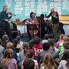 SAM GORESH/Staff photo. From left: Colin Jacobsen on violin, Michael Nicolas on cello and Nicholas Cords on viola, three members of the string quartet Brooklyn Rider, perform for third graders at Rockport Elementary School. 1/24/17