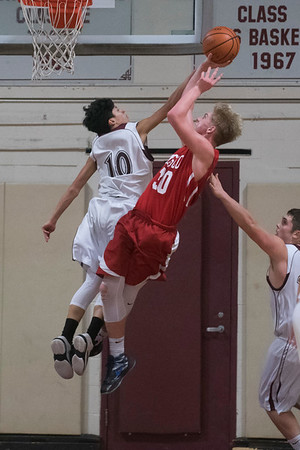 SAM GORESH/Staff photo. Masconomet's Harrison Greenside prepares to shoot the ball as Rockport's Ezra Mendoza attempts to stop him on defense in their game at Rockport High School. 1/24/17