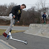 RYAN HUTTON/ Staff photo<br /> Danny Fournier, 12, flips his scooter around while in the air on the half pipe at the skate park at O'Maley Innovation Middle School as his friends Cam Mickels, 11, and Stanley Ramos, 13, wait their turn.