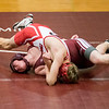SAM GORESH/Staff photo. Gloucester's Liam Donahue wrestles Tyngsboro's Matt Butler in the 146 pound bout during the Super Quad tournament. 1/7/17