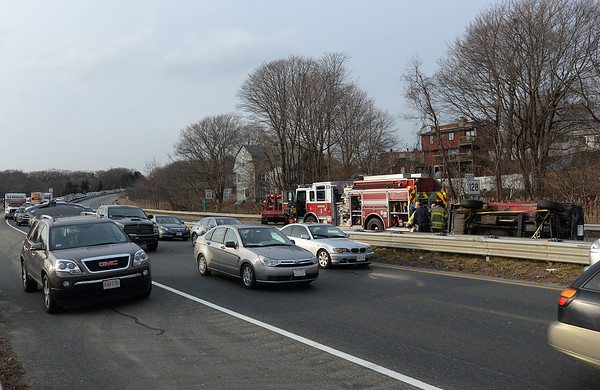 RYAN HUTTON/ Staff photo<br /> A rollover accident at Grant Circle back up traffic on Rt. 128 on Tuesday afternoon.