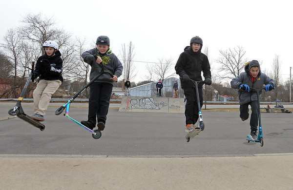 RYAN HUTTON/ Staff photo<br /> From left, Russell Kenyon, 12, Ryan Laflam, 11, Stanley Ramos, 13, and Greg Auditore, 13, all take to the air after hitting a ramp at the skate park at O'Maley Innovation Middle School.