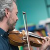 SAM GORESH/Staff photo.Colin Jacobsen plays the violin with two other members of the string quartet Brooklyn Rider as they perform for third graders at Rockport Elementary School. 1/24/17
