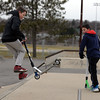 RYAN HUTTON/ Staff photo<br /> Danny Fournier, 12, lands a trick at the skate park at O'Maley Innovation Middle School as his friend Cam Mickels, 11, looks on.