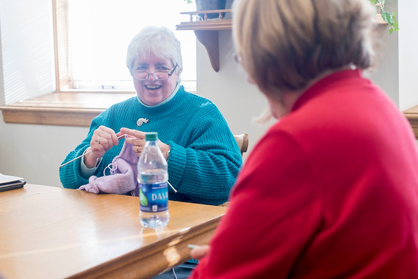 "Camilla Ayers (left) chats with Dianne Wemyss (right) as they knit and crochet during the ""Which Craft? Circle"" at the Rockport Public Library. Ayers founded the group and decided to call it ""Which Craft"" so that people could bring all types of needle crafts to the group. Ayers is knitting a sweater for a cousin's baby and Wemyss is crocheting an afghan for a niece's wedding present. 1/9/17"