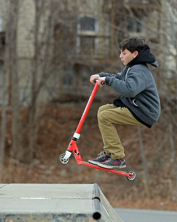 RYAN HUTTON/ Staff photo<br /> Joshua Giamanco, 11, gets ready to stick the landing on the half pipe at the skate park at O'Maley Innovation Middle School.