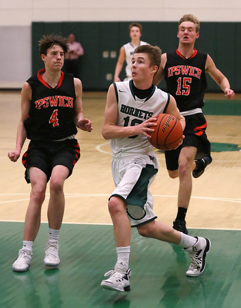 MIKE SPRINGER/Staff photo   <br /> Kellen Furse of Manchester Essex drives the ball past Zachary Long, left, and Alex Bruhm of Ipswich during varsity basketball action Wednesday in Manchester.<br /> 01/10/2018