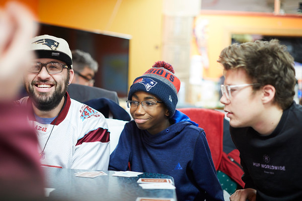 (L-R) Chris Beaton adviser to the club, Martin Opara, & Adam Jerome play the game Anomia to help pass the time at the 21st Annual Rock-A-Thon to help feed those in need at the Teen Center in Gloucester, Saturday, January 13, 2018. Jared Charney / Photo