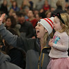 MIKE SPRINGER/Staff photo<br /> Deirdre Brown and her daughter Callie, 3, watch Callie's big sister Madelyn, a first grader, in a winter sing-along Friday morning at West Parish Elementary School in Gloucester. Families were invited to attend the event to make up for the absence of a holiday concert for families in December.<br /> 01/19/2018