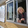 MIKE SPRINGER/Staff photo<br /> Amy Ahearn in the drive-up window of her new coffee business at DownRiver Ice Cream, 241 John Wise Avenue,  Rt. 133, in Essex.<br /> 01/05/2018