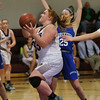 MIKE SPRINGER/Staff photo<br /> Rockport's Lauren Ryan drives the ball past Nicole Donnelly of Georgetown as she goes up for a layup during varsity basketball action Monday in Rockport.<br /> 01/15/2018