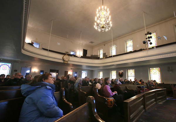 MIKE SPRINGER/Staff photo<br /> Audience members listen to a speaker during a Martin Luther King Day celebration Monday at the Gloucester Meetinghouse.<br /> 01/15/2018