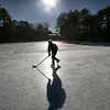 MIKE SPRINGER/Staff photo<br /> Greg Snyder of Manchester practices his hockey skills Tuesday on the frozen surface of Dexter's Pond in Manchester.<br /> 01/02/2018