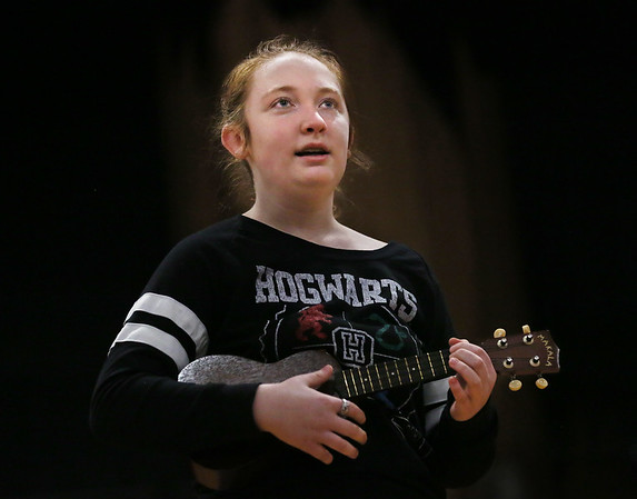 MIKE SPRINGER/Staff photo<br /> Eighth-grader Shannon Connolly plays the ukulele and sings during a rehearsal Tuesday for the third annual student talent show at O'Maley Innovation Middle School in Gloucester. The talent show will be staged on Friday at 7 p.m. in the school auditorium. Admission will be $5, with children 5 and under being admitted for free.<br /> 01/16/2018