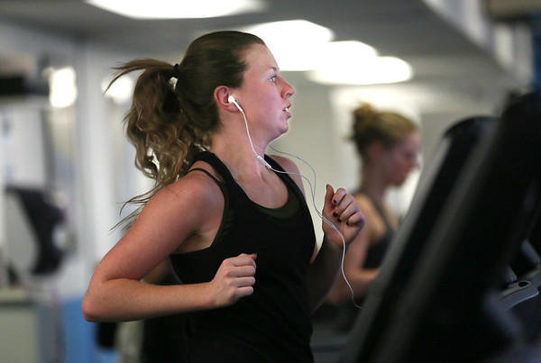 MIKE SPRINGER/Staff photo<br /> Jennavie Orrell of Gloucester works out Tuesday at the Cape Ann YMCA in Gloucester. Area gyms were filled with people burning off holiday calories and working on New Year's resolutions.<br /> 01/02/2018