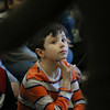 MIKE SPRINGER/Staff photo<br /> Fourth-grader Landen Cusick listens to the Akropolis Reed Quintet on Thursday at Veterans Elementary School.<br /> 01/25/2018