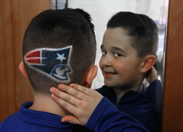 """MIKE SPRINGER/Staff photo<br /> Connor Olviera, a third grader at West Parish Elementary School, shows off his New England Patriots haircut Thursday in Gloucester. Connor had the special haircut and coloring work done at a barbershop in Somerville. He's not sure how long the logo will last before the colors fade. """"I want it to last until the Super Bowl,"""" he said. """"That would be cool.""""<br /> 01/25/2018 ORG XMIT: 180125_SN_MSP_HAIRCUT [[MER1801251437443889]]"""