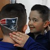"MIKE SPRINGER/Staff photo<br /> Connor Olviera, a third grader at West Parish Elementary School, shows off his New England Patriots haircut Thursday in Gloucester. Connor had the special haircut and coloring work done at a barbershop in Somerville. He's not sure how long the logo will last before the colors fade. ""I want it to last until the Super Bowl,"" he said. ""That would be cool.""<br /> 01/25/2018 ORG XMIT: 180125_SN_MSP_HAIRCUT [[MER1801251437443889]]"