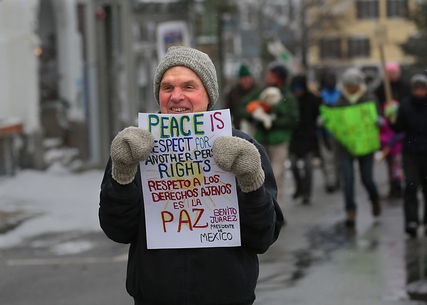 MIKE SPRINGER/Staff photo<br /> John Prybot of Gloucester waliks in the Rockport Unitarian Universalist Society's 30th annual march in honor of Rev. Martin Luther King Jr. on Monday in downtown Rockport.<br /> 01/15/2018