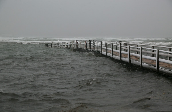 MIKE SPRINGER/Staff photo<br /> The footbridge at Good Harbor Beach is swamped by seawater at high tide during the storm Thursday in Gloucester.<br /> 01/04/2018