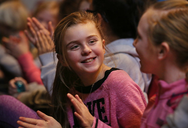 MIKE SPRINGER/Staff photo   <br /> Fifth=grader Tess Carpenter, left, applauds along with classmate Emily Prinn during an educational performance Wednesday by members of the Cape Ann Symphony at Manchester Memorial School.<br /> 01/10/2018
