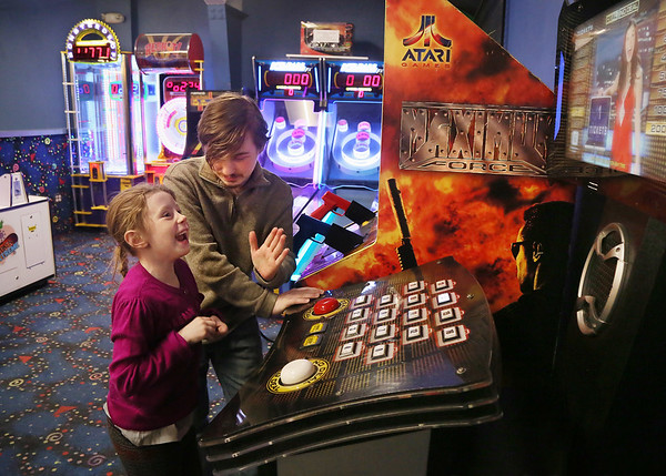 MIKE SPRINGER/Staff photo   <br /> Six-year-old Skyler Elizabeth Kinsman is congratulated by her uncle, Dakota Orlando, after winning a video game Wednesday at the Cape Ann Lanes in Gloucester.<br /> 01/10/2018