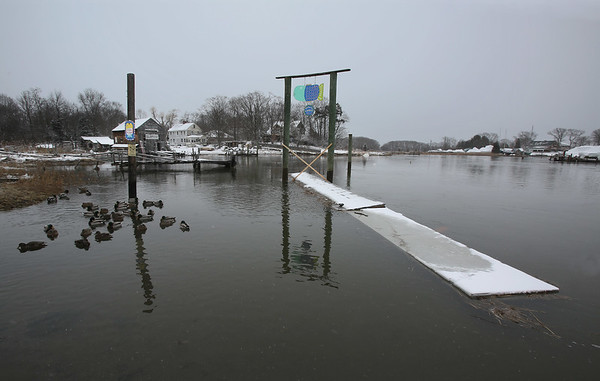 MIKE SPRINGER/Staff photo<br /> The town dock floats out in the harbor Tuesday morning in Essex, after an astronomical high tide lifted it up and caused it to float away from the shore.<br /> 01/30/2018