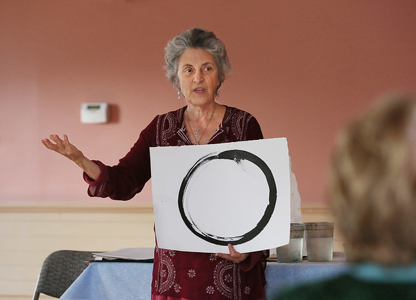 "MIKE SPRINGER/Staff photo   <br /> Carla Mattioli of Rockport teaches the first lesson in a ""Joy of Chinese Brush Painting"" class Tuesday at the Rockport Senior Center. The class will meet on Tuesdays from 1:30 to 3?30 p.m.<br /> 01/16/2018"