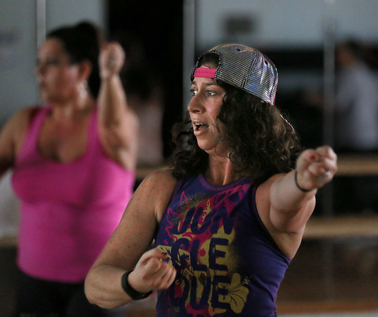 MIKE SPRINGER/Staff photo<br /> Lori Lampert leads a Zumba session Friday at the Cape Ann YMCA in Gloucester. The YMCA offers Zumba classes of varying degrees of intensity throughout the week. <br /> 01/12/2018