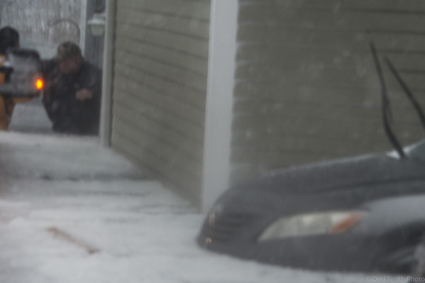 Desi Smith Photo. Desi Smith Photo.   Gloucester Firfighter James Hannon leads Neil Marshall from his apartment to the back of a pickup truck after four feet of water trapped him in his apartment on Western Ave at the height of yesterdays storm.  Gloucester Harbor Master, C.J Ciarametaro, backed his pickup down a driveway in about four feet of icey water to the back door were, Master Deputy Harbormaster Chad Johnson and Detective Jonathan Trefry pulled him in back of the truck and transferd him to an awaiting ambulance.    January 4,2018