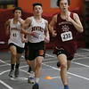 MIKE SPRINGER/Staff photo<br /> Gloucester's Kory Hurd, right, leads the pack on his way to victory in the 600-meter run during an NEC meet Thursday in Beverly.<br /> 01/11/2018