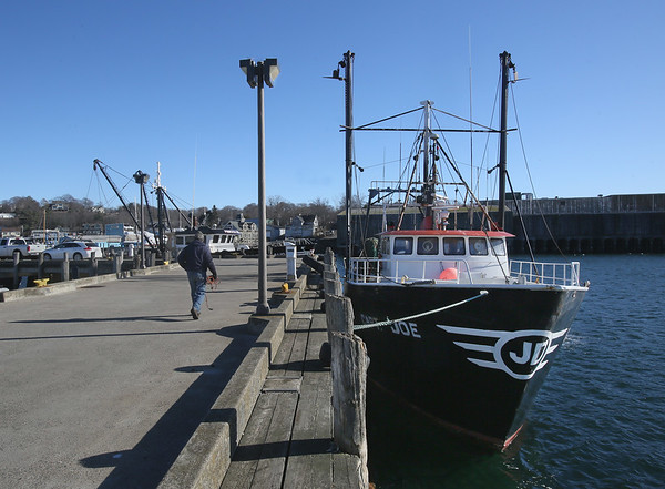 MIKE SPRINGER/Staff photo<br /> The trawler Capt. Joe is tied up Thursday at the Jodrey State Fish Pier in Gloucester.<br /> 01/25/2018