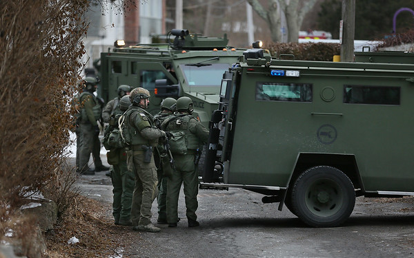 MIKE SPRINGER/Staff photo   <br /> Members of a SWAT team from the Northeastern Massachusetts Law Enforcement Council (NEMLEC) stand behind two armored vehicles during a standoff Tuesday afternoon on Munsey Lane in the Lanesville neighborhood of Gloucester.<br /> 01/16/2018
