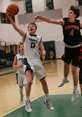 MIKE SPRINGER/Staff photo   <br /> Kellen Furse of Manchester Essex goes up for a layup under defensive pressure from Zachary Long of Ipswich during varsity basketball action Wednesday in Manchester.<br /> 01/10/2018