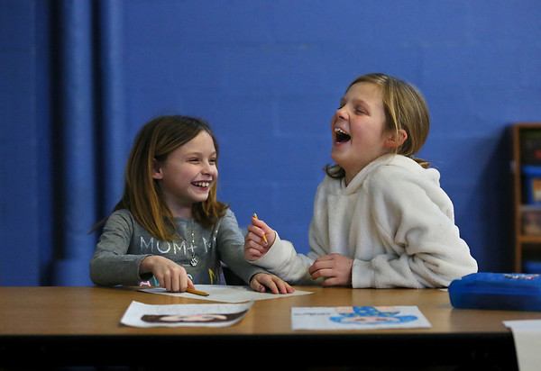 MIKE SPRINGER/Staff photo<br /> Third-graders Isabella Aiello, left, and Emma Texeira share a laugh while making drawings during the Cape Ann YMCA's after-school program at East Gloucester Elementary School.<br /> 01/19/2018