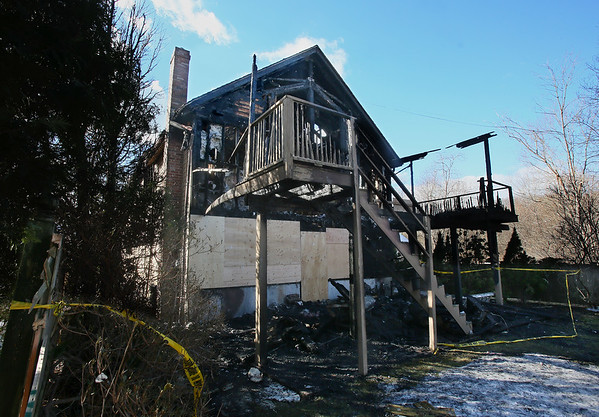 MIKE SPRINGER/Staff photo<br /> The rear side of the house at 12 Rockport Road in Gloucester as it appeared Tuesday morning, the day after a fire destroyed much of the structure.<br /> 01/09/2018