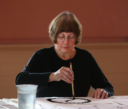 "MIKE SPRINGER/Staff photo   <br /> Anne Prybot takes part in a ""Joy of Chinese Brush Painting"" class Tuesday at the Rockport Senior Center. The class, taught by Carla Mattioli of Rockport, will meet on Tuesdays from 1:30 to 3:30 p.m.<br /> 01/16/2018"