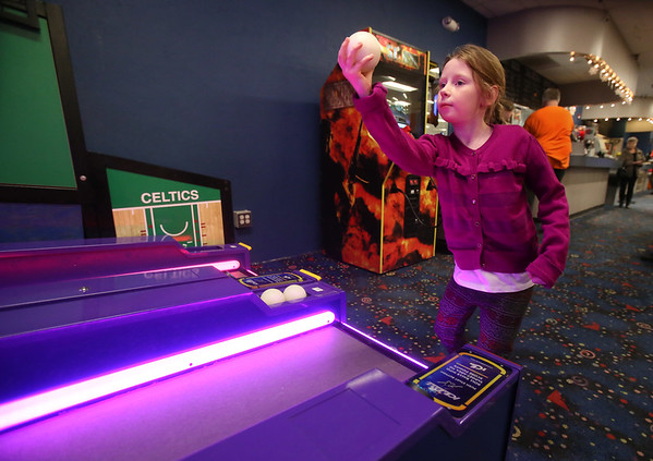 MIKE SPRINGER/Staff photo   <br /> Six-year-old Skyler Elizabeth Kinsman plays a game of ICE Ball on Wednesday in the video game arcade at the Cape Ann Lanes in Gloucester.<br /> 01/10/2018
