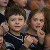 MIKE SPRINGER/Staff photo<br /> Kindergartners Grady Hale, left, and Rhyse Goodchild take part in a winter sing-along Friday morning at West Parish Elementary School in Gloucester. Families were invited to attend the event to make up for the absence of a holiday concert for families in December.<br /> 01/19/2018