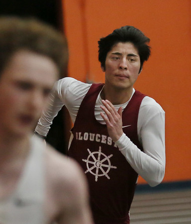 MIKE SPRINGER/Staff photo<br /> Gloucester's Elyas Chahoshi competes in the 300-meter run during an NEC meet Thursday in Beverly.<br /> 01/11/2018